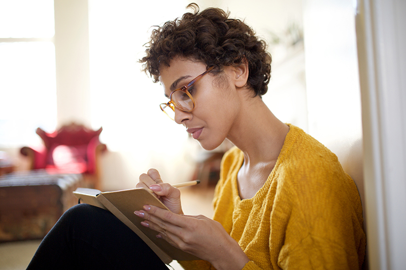 woman sitting and journaling