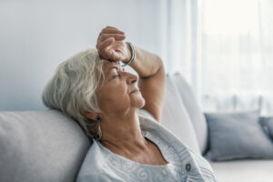Elderly woman experiencing extreme fatigue.