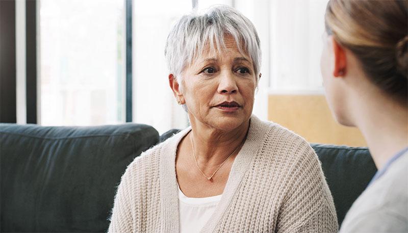 concerned-senior-woman-talking-with-caregiver