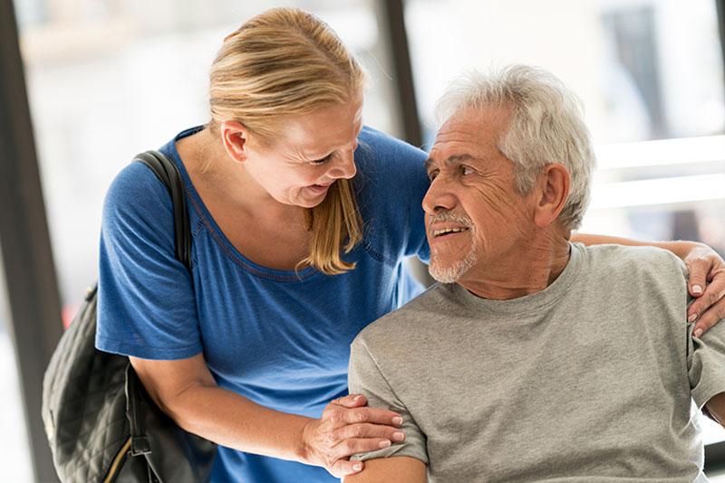 caregiver-comforting-senior-man-with-dementia